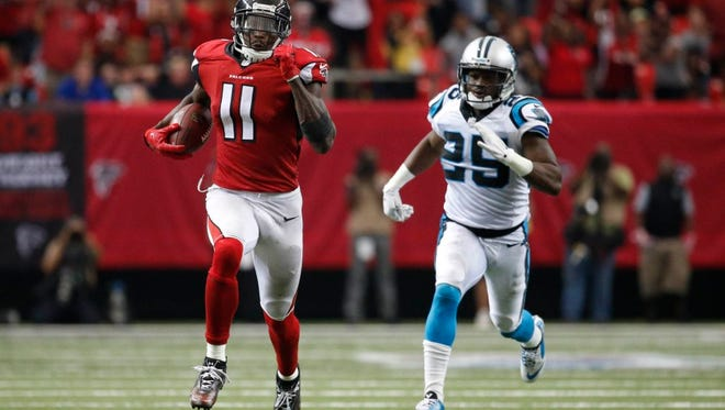 Falcons wide receiver Julio Jones (11) runs for a touchdown in an Oct. 2 game against Carolina. Jones had 300 yards receiving that day.