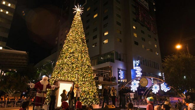 During City Skate, an ice skating rink and large decorated tree are set up in the middle of downtown Phoenix.