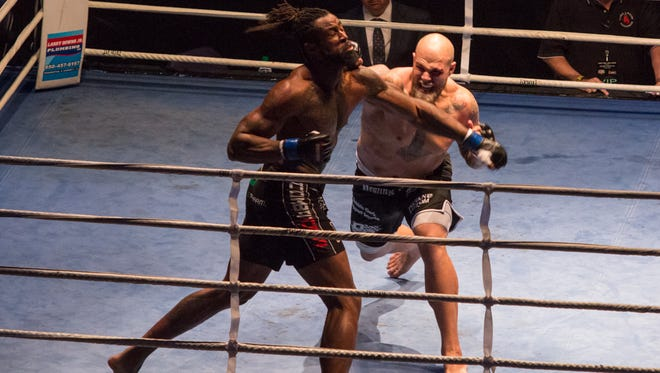 Dakota Merritt, red tape, takes on Seante Williams during Island Fights 39 at the Pensacola Bay Center Saturday night. Merritt won by knockout.