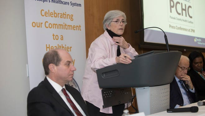 Maureen Deevey, senior program officer for the Nicholson Foundation, speaking at a meeting of a network of community-based organizations that want to implement expanded initiatives to improve the health of low-income residents of Paterson. Kevin Slavin, left, CEO of St. Joseph's Healthcare System, and U.S. Rep. William Pascrell Jr. attended.