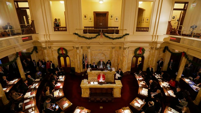 New Jersey senators conduct business at the State House in Trenton.