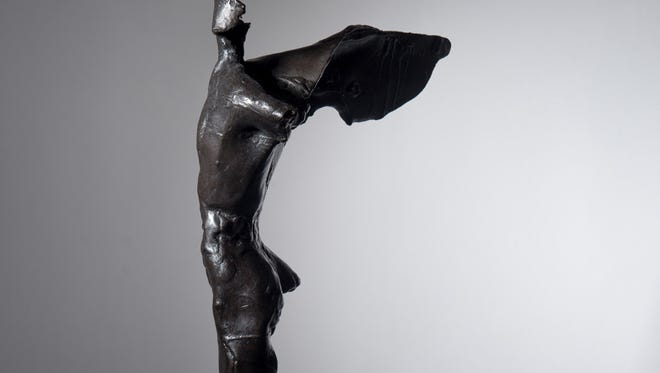"""The Governor's Arts Award, entitled """"Fragment,"""" was designed by William Dunlap and cast in bronze by Lugar Foundry."""