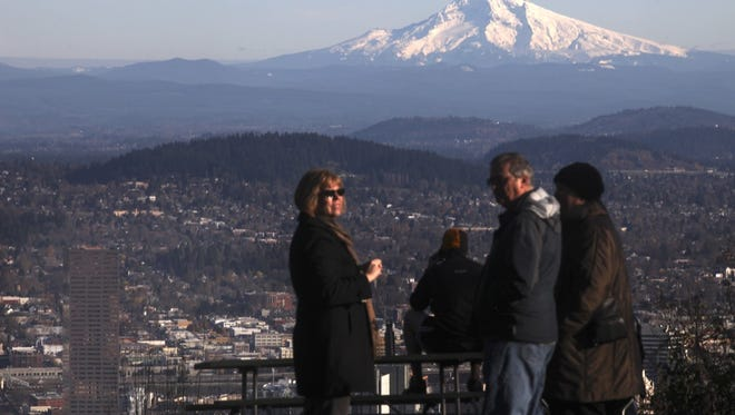 Statesman Journal file Visitors enjoy an iconic view of Mount Hood from Pittock Mansion.