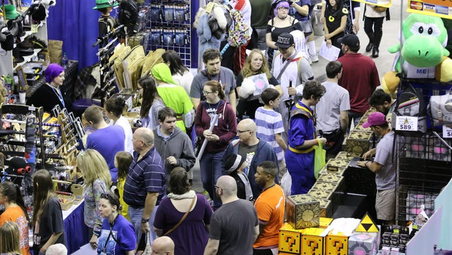 People continue their journey through Pensacon 2017 at the Pensacola Grand Hotel and the Pensacola Bay Center Sunday afternoon.