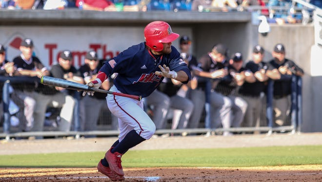 South Alabama's Drew LaBounty lays down a sacrifice bunt to advance Dylan Hardy to second base during the Cox Diamond Invitational Saturday afternoon at Blue Wahoos Stadium.