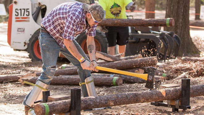 Men and women compete in the 29th annual Northwest Florida Forestry Conclave Lumberjack Festival at Pensacola State College's Milton Campus Saturday.  The competition was split into two age categories, 13-15 and 16+, for the various events, such as chopping, compass & pacing, pole tossing, knife throwing and more.