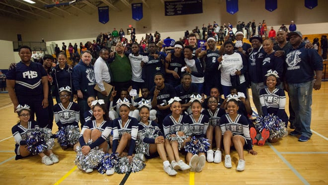 The Poughkeepsie High School basketball team poses with the cheerleaders after winning the Section 9 Class A championship on March 5.