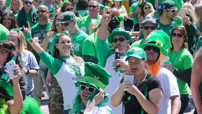 """Hundreds of people got into the St. Patrick's Day spirit at Crabs We Got 'Em, Holiday Inn Resort, Paddy O'Leary's Irish Pub, Paradise Bar & Grill and Flounders Chowder House during the Pensacola Beach Chamber of Commerce's 2017 """"Go Irish on the Island"""" St. Paddy's Day pub crawl."""