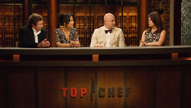 """TOP CHEF -- """"Southern Hospitality"""" Episode 1402 -- Pictured: (l-r) Frank Lee, Padma Lakshmi, Tom Colicchio, Gail Simmons -- (Photo by: Paul Cheney/Bravo)"""