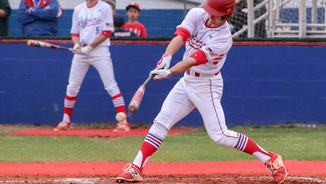 Pace's Andrew Bates (27) hits a single into right field against Niceville Friday night at Pace High School.