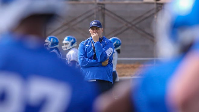 Head coach Pete Shinnick looks on as the University of West Florida football team runs through its first spring practice at UWF's Pen Air Field on March 25.