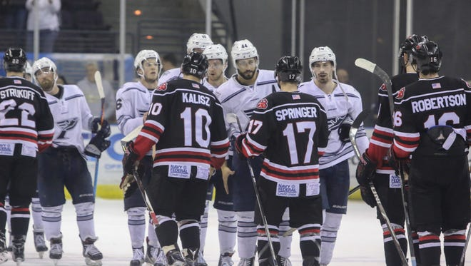 The Ice Flyers shake hands with the Fayetteville FireAntz after winning their first-round playoff series in April. The Ice Flyers will open the 2017-18 season on the road in Macon, the defending SPHL champions, on Oct. 20.