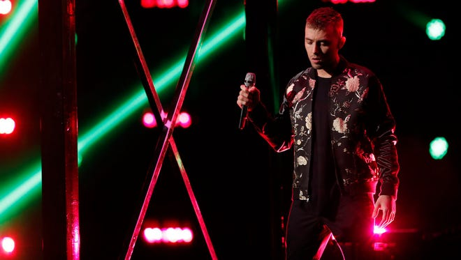 """Hunter Plake, a worship leader at Crossroads Church in Lafayette, sings during the live playoffs Monday on """"The Voice."""""""