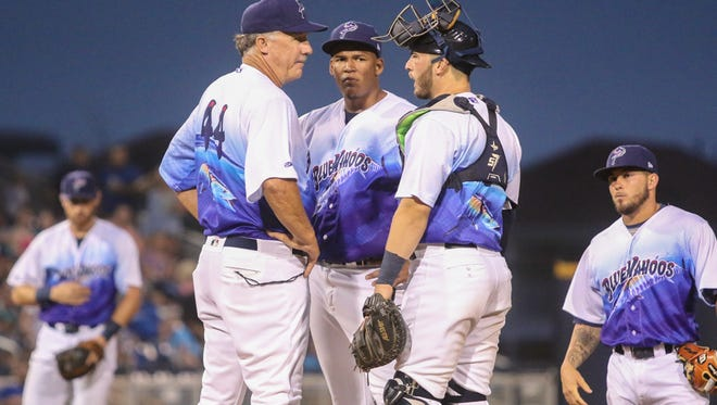 Blue Wahoos pitching coach Danny Darwin (44) and catcher Joe Hudson chat with starting pitcher Keury Mella in the third inning after he walked a hitter that allowed a run to score while the bases were loaded on Saturday, April 29, 2017.