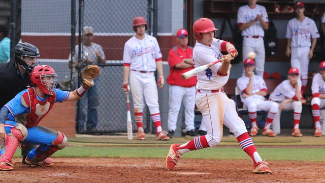 Pace's Dalton Childs (13) swings at a high pitch thrown by Pine Forest's Riley White during a rainy District 1-7A semifinal game at Tate High School on Wednesday, May 3, 2017.