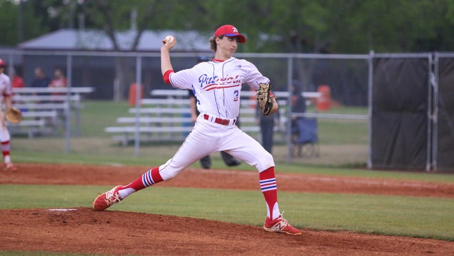 Pace's Brandon Sproat (3) pitches against Pine Forest during a rainy District 1-7A semifinal game at Tate High School on Wednesday, May 3, 2017.