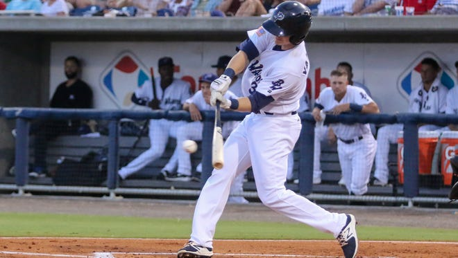 Pensacola's Josh VanMeter (3) hits a single into the outfield against the Birmingham Barons at Admiral Fetterman Field on Wednesday, May 10, 2017.