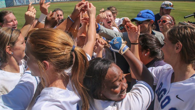 West Florida's softball team celebrates their victory over Valdosta State in the NCAA Division II South 1 Regional Softball Tournament championship game at UWF on Saturday, May 13, 2017.