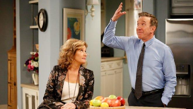 "Nancy Travis and Tim Allen spar in a scene on ABC's ""Last Man Standing."""