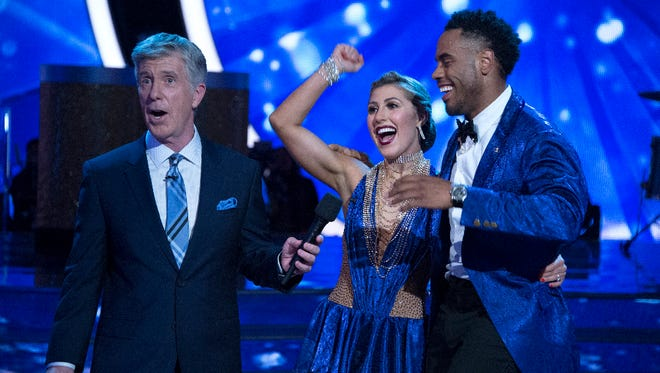 Tom Bergeron talks with Emma Slater and Rashad Jennings after their performance.