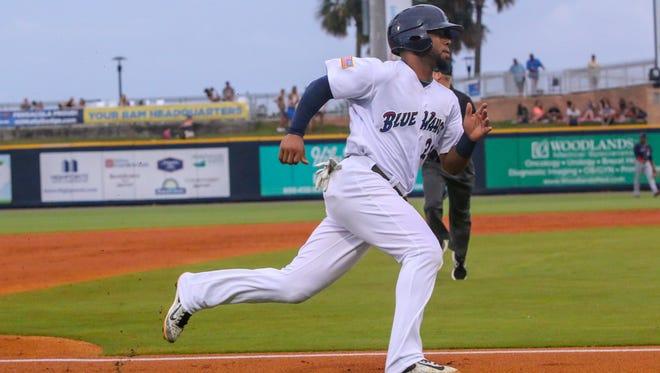 Pensacola's Angelo Gumbs (24) races home on an RBI double hit by Joe Hudson against the Jacksonville Jumbo Shrimp at Admiral Fetterman Field on Thursday, June 01, 2017.
