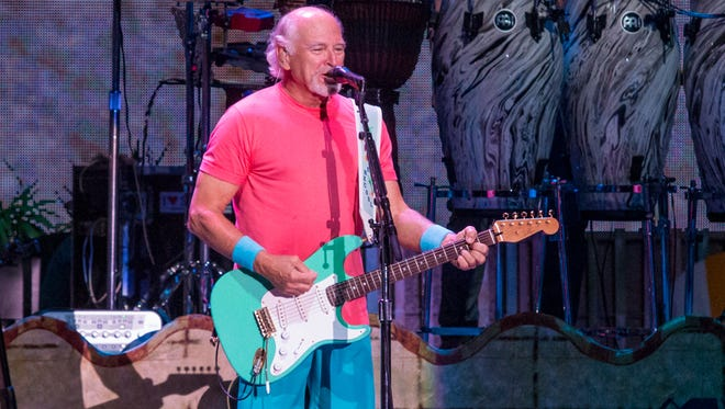 """Jimmy Buffett and the Coral Reefer Band performs during the """"I Don't Know"""" tour at The Wharf Amphitheater in Orange Beach, Alabama, on June 6, 2017."""
