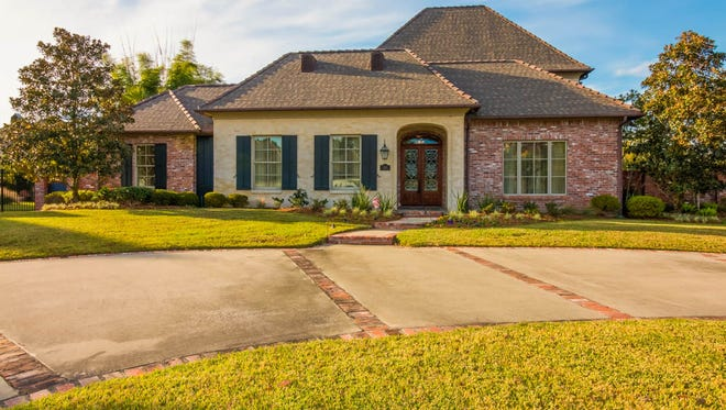 This four bedroom, three and one half bath home is located at 303 Sawgrass Lane in Broussard. It is listed at $1,100,000.