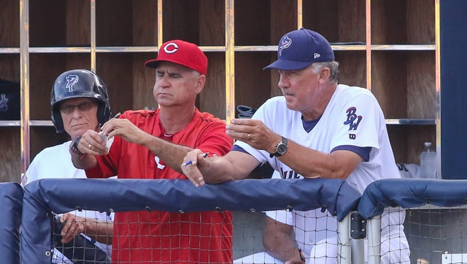 Cincinnati Reds pitching coordinator Tony Fossas (left), speaks with former Blue Wahoos pitching coach Danny Darwin during a game last season. Darwin is now the Reds pitching coach, Fossas will be in Pensacola this weekend as a temporary pitching coach.