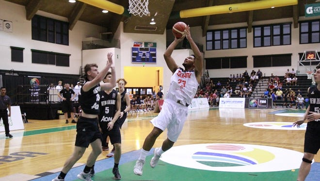Guam's D'aundre Cruz goes for an uncontested layup against New Zealand early in their match. New Zealand won, 90-78.