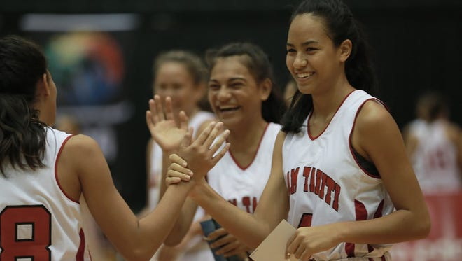 In this file photo, Tahiti players congratulate each other during a basketball game against New Caledonia.