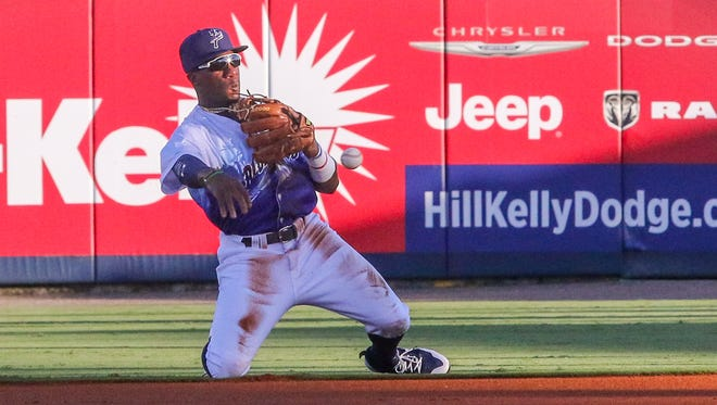 Blue Wahoos second baseman Shed Long (2) dives to stop the ball and gets to his knees in time to throw Mississippi's Stephen Gaylor out at first base at Blue Wahoos Stadium on Saturday, July 15, 2017.
