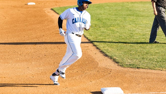 Canary outfielder Jabari Henry rounds third on one of his 15 home runs this season.