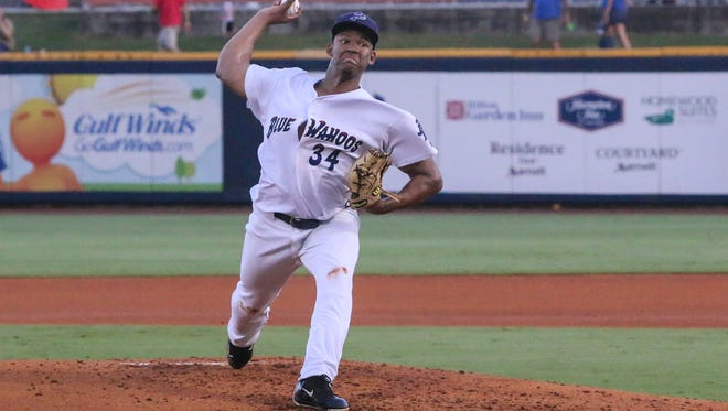 Blue Wahoos pitcher Keury Mella (34) throws against the Biloxi Shuckers at Blue Wahoos Stadium on Tuesday, July 25, 2017.