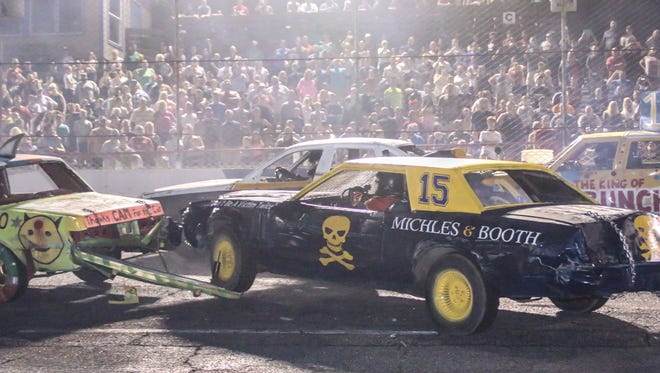 Drivers work to eliminate each other during the demolition derby at Five Flags Speedway on Friday, August 11, 2017.