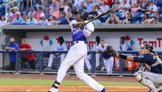 Pensacola's Gabriel Guerrero (23) crushes a three-run homerun on a pitch by Mobile's Jake Jewell at Blue Wahoos Stadium on Saturday, August 12, 2017.