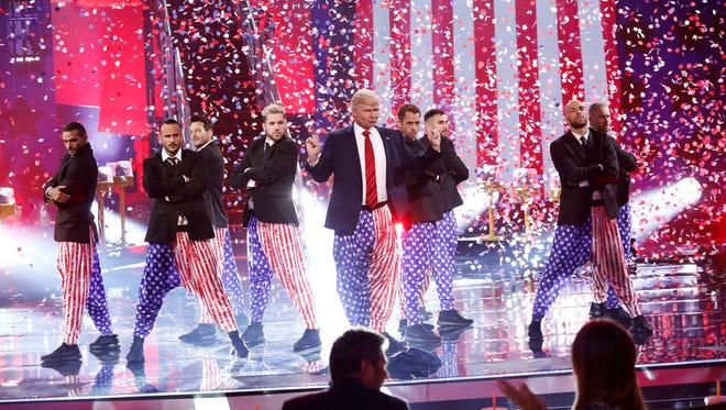 """The Singing Trump (Jeff Tracta of Palm Springs) performs during the """"America's Got Talent""""  Live Show, Aug. 15, 2017."""