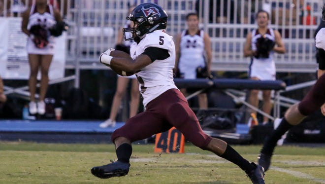 Navarre's Dante Wright (5) intercepts a Wildcats pass and runs back up the field at Washington High School on Friday, Sept. 1, 2017.