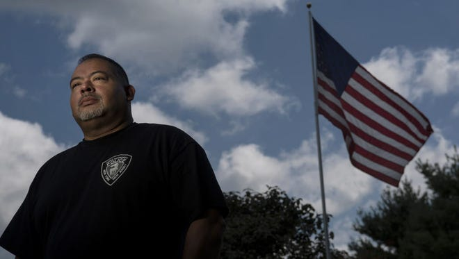 Will Jimeno is a Port Authority Police Department officer who survived the September 11 attacks in 2001. Jimeno at his home.    Will Jimeno is a Port Authority Police Department officer who survived the September 11 attacks in 2001. Jimeno at his home.      MICHAEL KARAS / STAFF PHOTOGRAPHER