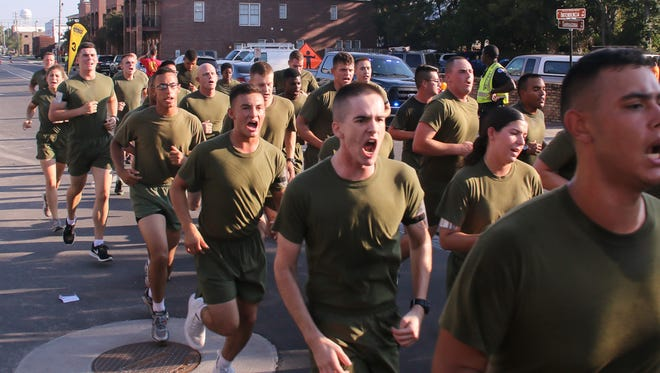 Runners make their way through downtown Pensacola during the 34th annual Semper Fi 5K charity run on Saturday, Sept. 9, 2017.
