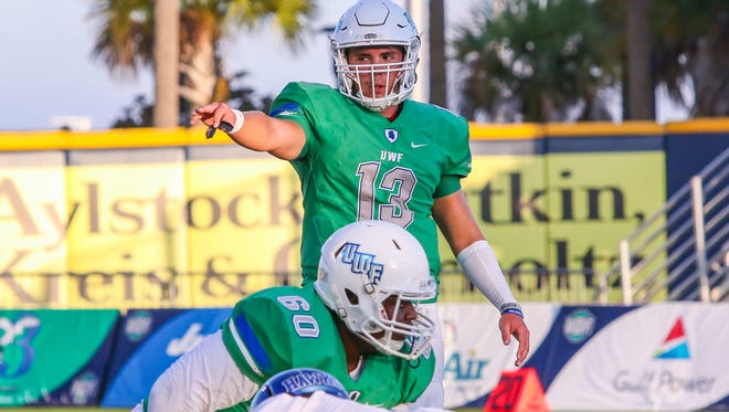 UWF quarterback Mike Beaudry (13) signals to the wide receivers in first home game of the 2017 season at Blue Wahoos Stadium on Saturday, Sept. 16, 2017.