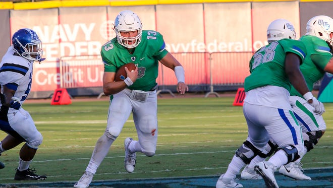 UWF quarterback Mike Beaudry (13) keeps the ball and races up the middle of the field against Chowan University in first home game of the 2017 season at Blue Wahoos Stadium on Saturday, Sept. 16, 2017.