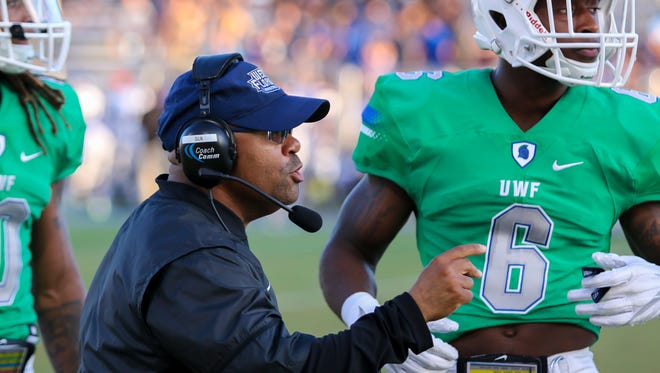 UWF defensive line coordinator Darian Dulin goes over a play with defensive back Josh Marshall (6) during last Saturday's game against Chowan at Blue Wahoos Stadium.