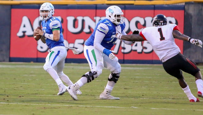 UWF's Tomarick Collier (77) keeps Valdosta State's Guito Ervilus (1) from quarterback Mike Beaudry (13) at Blue Wahoos Stadium on Saturday, Sept. 23, 2017.