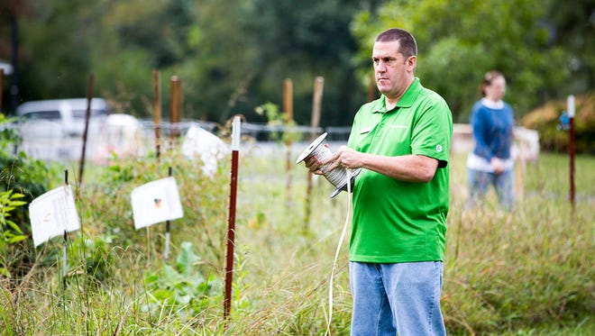 Tom Sayers, district manager at Publix Super Markets, helps take down fencing at the Fairview Garden on Sept. 14 as part of United Way of Williamson County's 2017 Days of Caring.