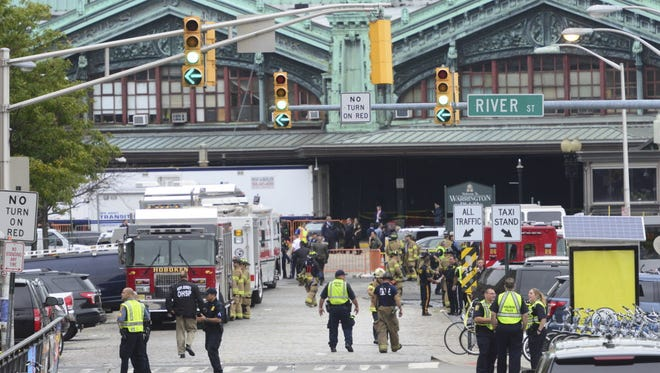 Emergency personnel respond to a train crash in the Hoboken train station, in Hoboken, N.J.