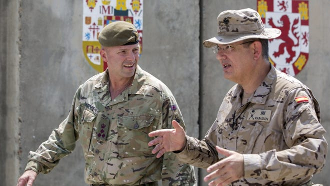 British army Brig. Gen. Frazer M. Lawrence, deputy commanding general of operations for the Combined Joint Forces Land Component Command, left, speaks with Spanish army Brig. Gen. D. Luis Martin-Rabadan, commander of Task Force Besmaya, during his visit to the Besmaya Range Complex in August.