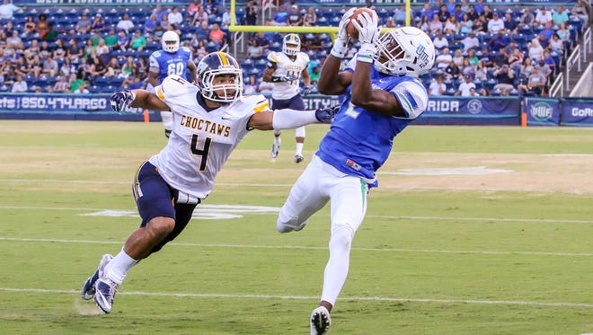 UWF's Rodney Coates (2) beats Mississippi College's Blake Miller (4) and comes down with a first down catch at Blue Wahoos Stadium on Friday, Oct. 6, 2017.  The game originally was scheduled for Saturday, but was moved up a day due to concerns about the forecast of Tropical Storm Nate.