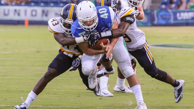 UWF running back Chris Schwarz (40) runs the ball against the Mississippi College Choctaws at Blue Wahoos Stadium on Friday, Oct. 6, 2017.  The game originally was scheduled for Saturday, but was moved up a day due to concerns about the forecast of Tropical Storm Nate.