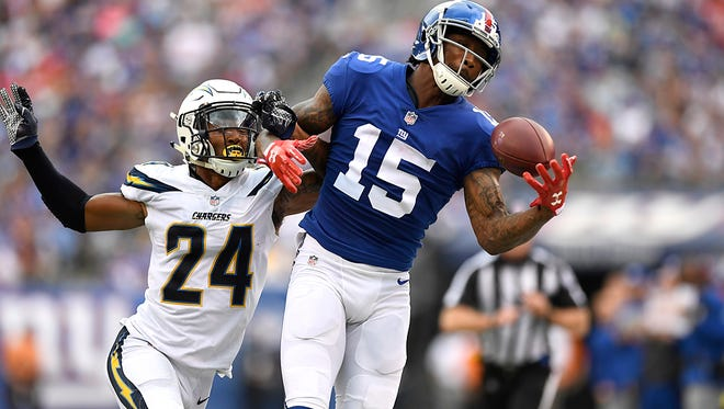 New York Giants wide receiver Brandon Marshall #15 makes a one-handed catch but he was later ruled out of bounds. Marshall left the game with an apparent ankle injury after this play. The New York Giants lead the Los Angeles Chargers 9-7 in the first half on Sunday, October 8, 2017 in East Rutherford, NJ.