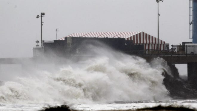 Waves crash on the amusement pier in Atlantic City as Superstorm Sandy hits the area on Oct. 29, 2012.